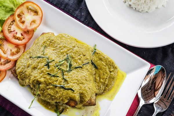 thai fish fillet with asian green curry sauce meal and rice