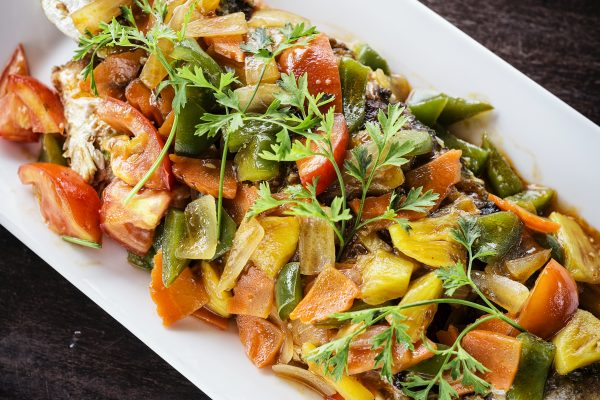 asian spicy grilled fish with sweet and sour vegetables